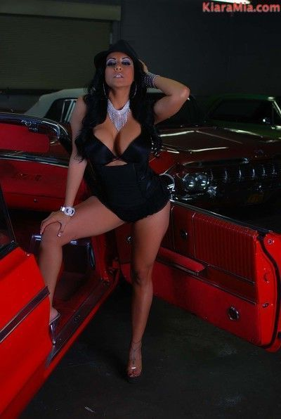 Sexy chicana kiara mia poses next to this low rider. she gets so hot and horny s