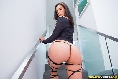 Ravishing MILF with big tits and ample ass posing in provocative outfit