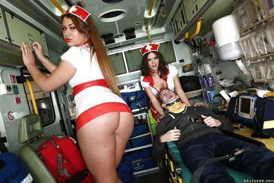 Uniformed nurse Clarita Gold and her assistant treating a patient