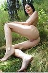 Sexy dress clad Euro Loreen A spreading legs to show pussy in the forest