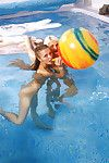 Petite teenage chicks have some lesbian fun using their toys in the pool