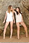 Lesbian teens Lucia D & Ryanel A showing wet shaved pussy & naked ass on beach