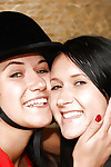 Hot lesbians Lucy Lee & Angelica playing with a dildo in the horse barn