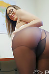 Female office worker Moka Mora rolls off her pantyhose to pose nude at work