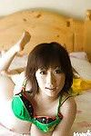 Full-bosomed asian coed Hanano Nono stripping off her underwear on the bed