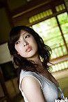 Bosomy asian cutie Saki Koto uncovering her seductive body