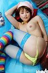 Asian teen Akiho Yoshizawa uncovering her petite titties and hairy slit