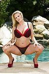 Curvaceous blonde MILF on high heels Zoey Holiday stripping by the pool