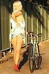 Girl with bleached blonde mullet riding bike with pantyless around town