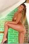 Leggy oiled glamour babe Melena A displaying small teen breasts
