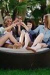 Four oiled teens in lesbian orgy
