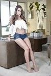 Barefoot babe Kimmy Granger showing off great legs in denim shorts