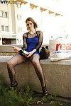 Amazingly lovely babe in pantyhose smoking and doing upskirt outdoor