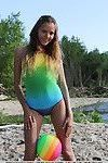 Sweet brunette filly Mango A reveals her shaved pussy at the beach