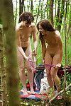 Two lesbians caught naked on spy camera in the woods put clothes back on