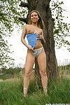 Cute blonde exhibitionist gets nude in a public park
