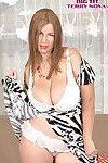 Fatty mature redhead Terry Nova bares massive boobs wearing sexy dress & heels