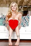 Leggy older blonde babe Julia Ann unleashing big tits from lingerie