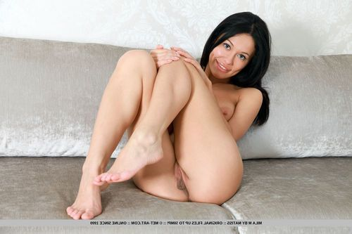 Dark brown Euro hotty Mila M exhibiting appealing legs and hairless gentile for glam pictures