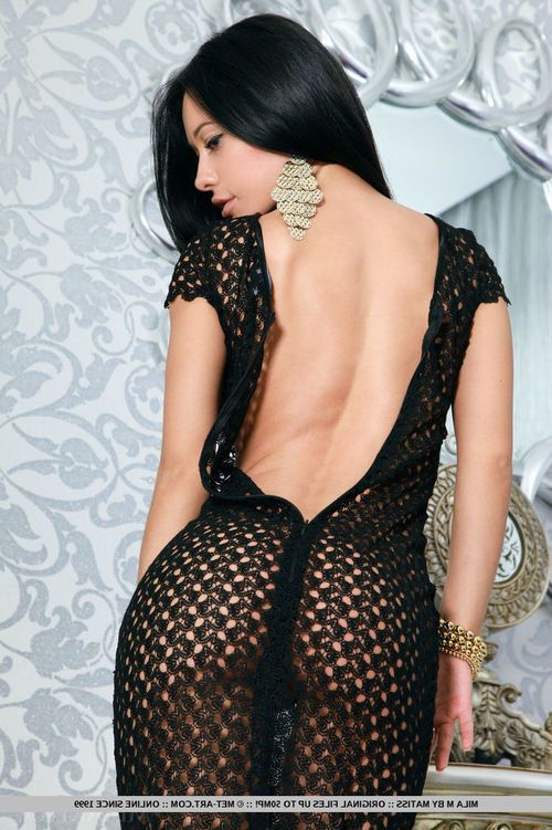 Brunette hair girl Mila M sets free vast juvenile mambos and arse from witness thru suit