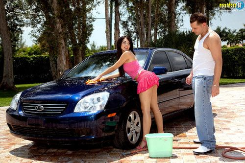 Elegant adolescent sasha bleu washing a car and