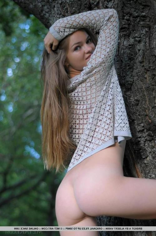 Pretty juvenile chicito Bridgit A posing for erotic tease keen outdoors in woods