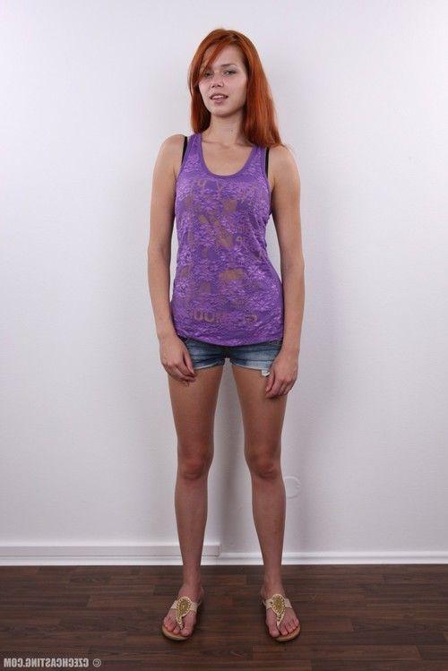 Elegant redhead adolescent standing exposed