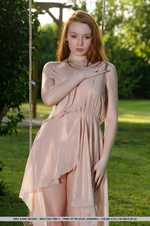 Redheaded juvenile Kloe Kane revealing whole freshman titties in park