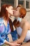 Nice-looking lesbian chicks aficionados tongueing in the sun