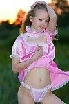 Compact infant princess without clothes outdoors