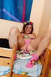 With a ring of flowers in her hair emily Teeny wears the cutest sheer pink underclothing