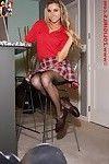 Leggy golden-haired gal in her schoolgirl uniform and hose