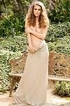 Playmate amberleigh west posing stripped in a concealed garden