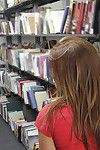 Giant butt dark brown darling Emma getting nude and flashing in a library