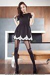 Brunette hair darling in knee socks and  exposing wild youthful legs in heels