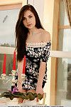 Brown hair doll in summer clothing exposing miniscule woman passports for glamour fotos