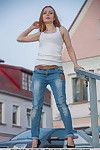 Dressed model in denim jeans exposing miniscule pantoons for glamour photo amplify