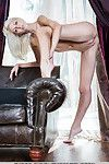 Limber blond pretty Lija showing off outstanding legs and love-cage in the unclothed