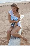 Fuckable brunette hair beauty with wonderful melons Viola stripped off down in the sand