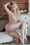 Pleasing blond pretty Skrlett takes her clothes off without her wild red underclothes