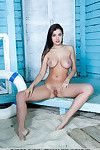 Bodily hottie with hard boobs Evita Lima stretches her unshaved cunt