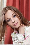 Smiley faced young Nikia A modeling for uncovered glamour slot in elegant stockings