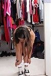 Elegant nineteen juvenile undressing and expanding her legs in changing room