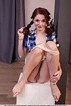 Young Euro hotty Leona Chico strutting in pigtails for glamour images