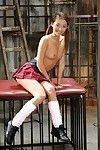 Adolescent Oriental pornstar Alina Li posing seductively in schoolgirl uniform