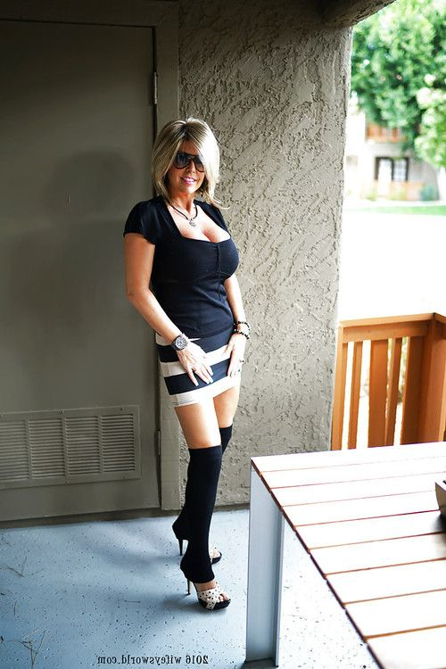Elderly housewife Sandra Otterson posing in OTK socks for pretty images