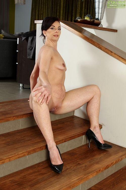 Leggy high heel wearing mellow broad Zoe Gyro revealing miniature zeppelins and apple bottoms