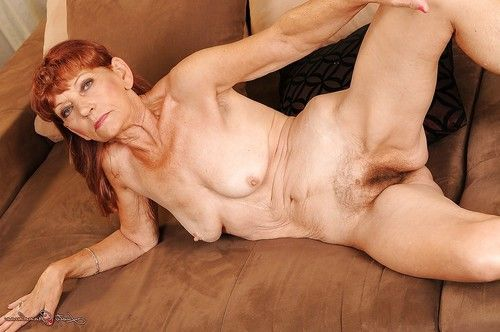 Redhead adult on high heels striptease and exposing her unshaved twat