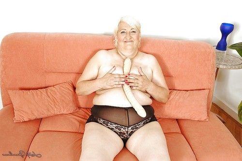 Fatty grown up stroking her bushy fur pie with a weighty sex toy