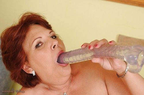 Fatty elderly with saggy love muffins undressing and playing with a large toy dick